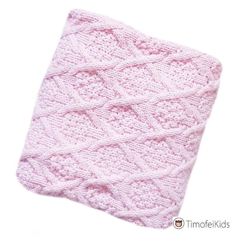 Розовый вязаный плед